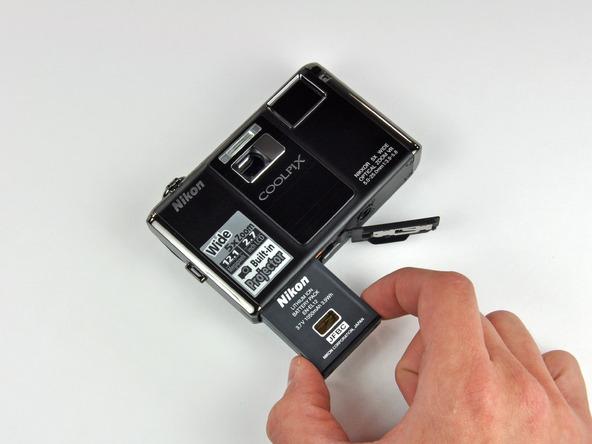 Как разобрать фотоаппарат Nikon Coolpix S1000pj (10)