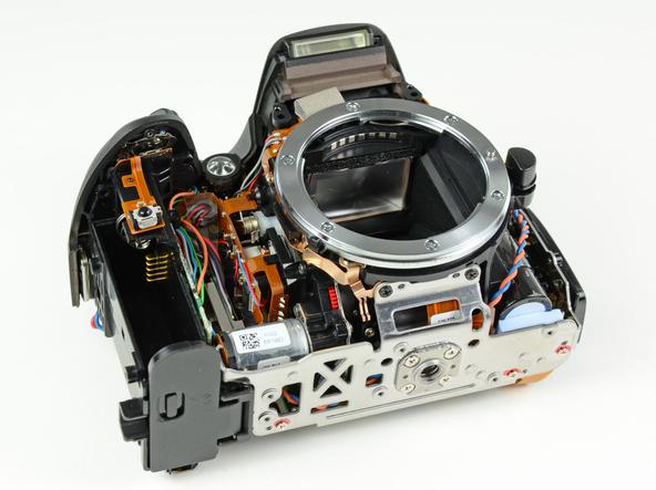 Как разобрать фотоаппарат Nikon D5100 (20)