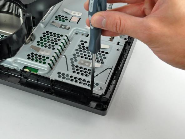 Как разобрать игровую консоль Sony PlayStation 3 Slim (43)