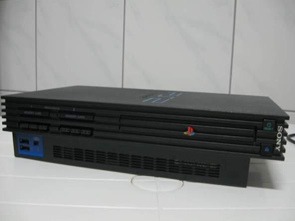 Как разобрать игровую консоль Sony PlayStation 2 (2)
