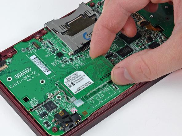 Как разобрать игровую консоль Nintendo DSi XL (13)