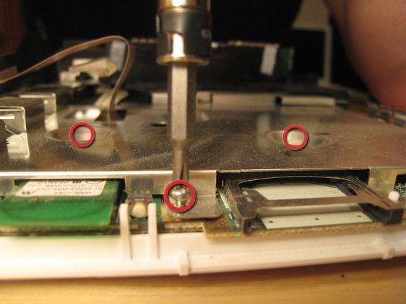 Как разобрать игровую консоль Nintendo Wii (35)