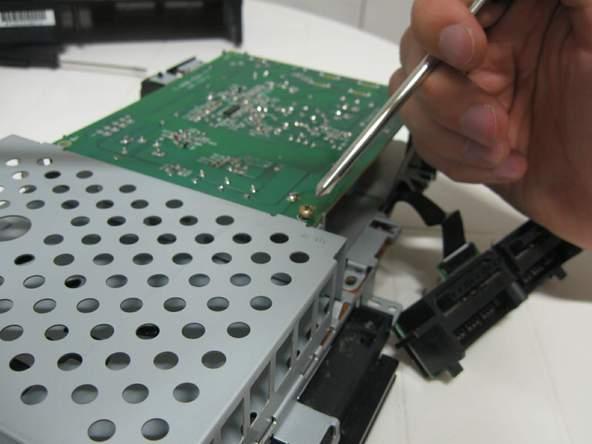 Как разобрать игровую консоль Sony PlayStation 2 (38)