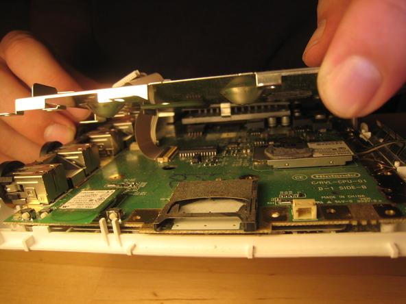 Как разобрать игровую консоль Nintendo Wii (47)