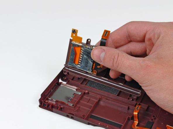 Как разобрать игровую консоль Nintendo DSi XL (30)