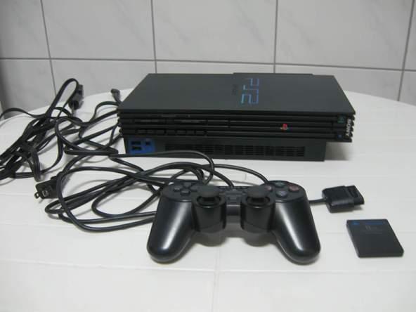 Как разобрать игровую консоль Sony PlayStation 2 (6)