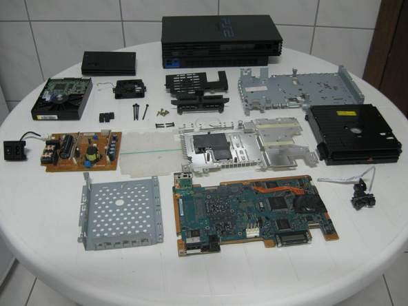 Как разобрать игровую консоль Sony PlayStation 2 (61)