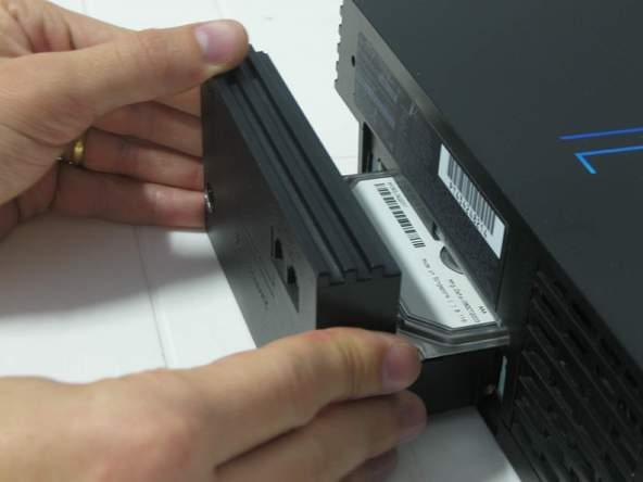 Как разобрать игровую консоль Sony PlayStation 2 (11)