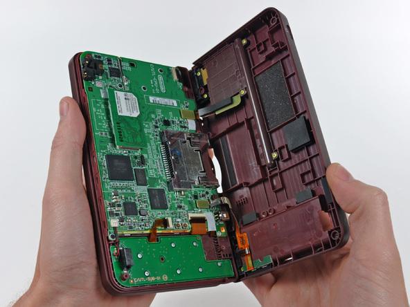 Как разобрать игровую консоль Nintendo DSi XL (11)