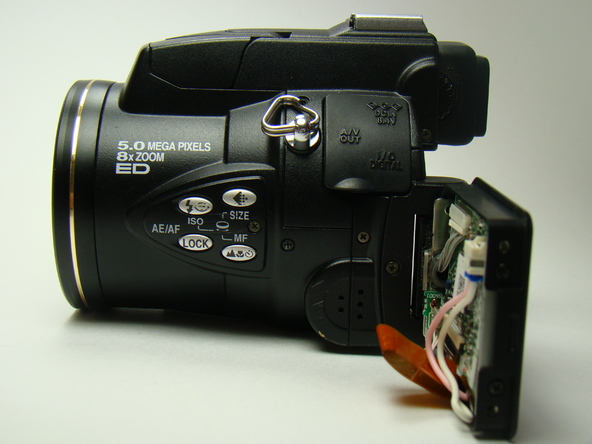 Как разобрать фотоаппарат Nikon Coolpix E5700 для замены различных компонентов (5)