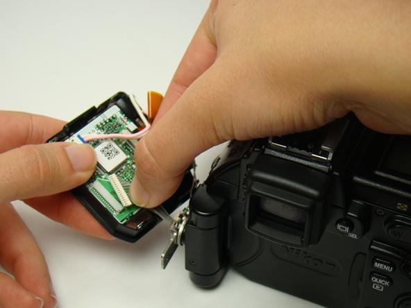 Как разобрать фотоаппарат Nikon Coolpix E5700 для замены различных компонентов (7)