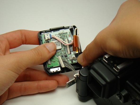 Как разобрать фотоаппарат Nikon Coolpix E5700 для замены различных компонентов (8)