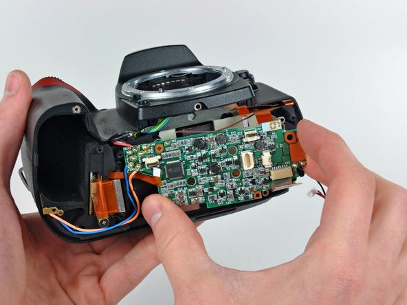 Как разобрать фотоаппарат Nikon D70 для замены различных компонентов (27)