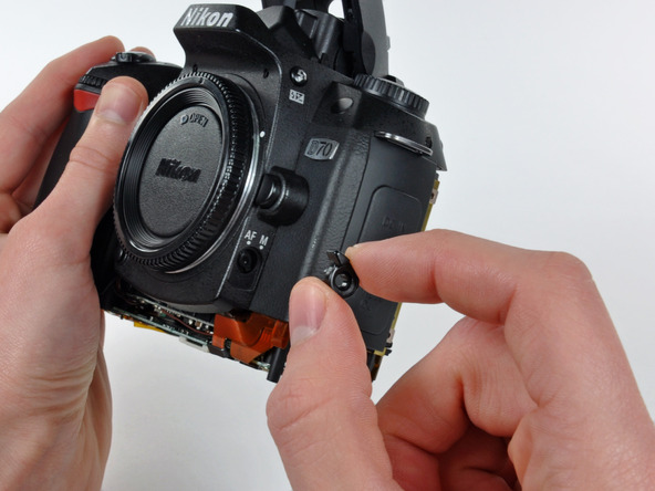 Как разобрать фотоаппарат Nikon D70 для замены различных компонентов (34)