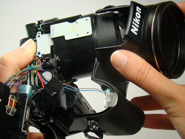 Как разобрать фотоаппарат Nikon Coolpix E5700 для замены различных компонентов (28)