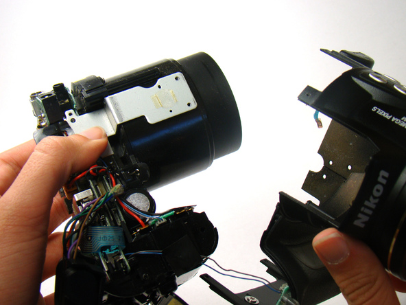Как разобрать фотоаппарат Nikon Coolpix E5700 для замены различных компонентов (29)