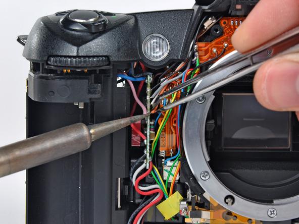 Как разобрать фотоаппарат Nikon D70 для замены различных компонентов (46)