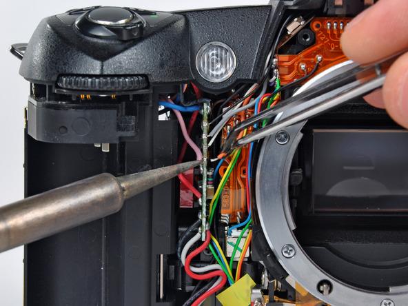 Как разобрать фотоаппарат Nikon D70 для замены различных компонентов (47)