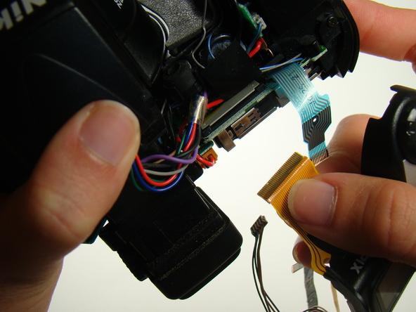 Как разобрать фотоаппарат Nikon Coolpix E5700 для замены различных компонентов (57)