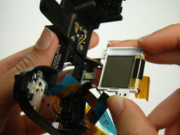 Как разобрать фотоаппарат Nikon Coolpix E5700 для замены различных компонентов (61)